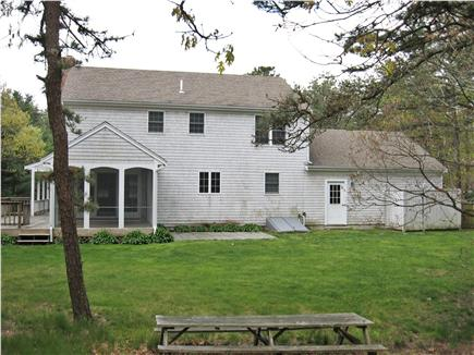 Dennis Cape Cod vacation rental - Back of house/screened porch/outdoor shower to the right.