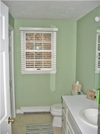 Dennis Cape Cod vacation rental - First floor half bath with washer/ new dryer(2012) in closet.