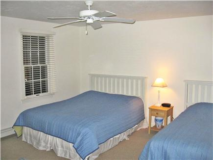 Dennis Cape Cod vacation rental - Second floor bedroom with queen & twin beds/T.V. with DVD player.
