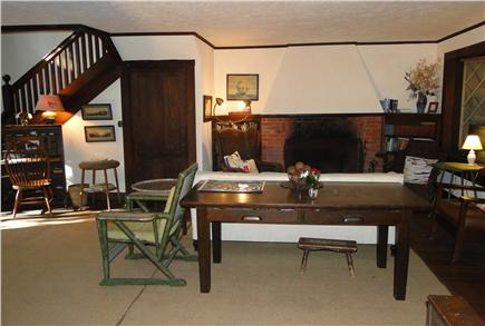 Pocasset, MA Cape Cod vacation rental - Large living room w/ fireplace & door to back deck, facing water