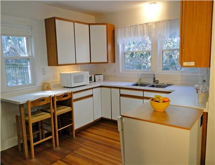 Pocasset, MA Cape Cod vacation rental - Kitchen area with door to yard and beach area