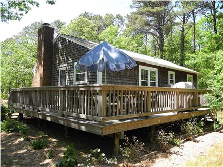 Eastham Cape Cod vacation rental - Deck with patio furniture and grill overlooks private back yard