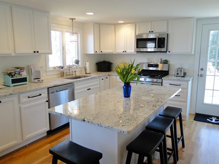 Pocasset Pocasset vacation rental - Clean, bright kitchen w/ stainless steel appliances, door to deck