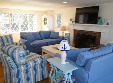 Pocasset Pocasset vacation rental - Bright, spacious living room with fireplace and slider to deck