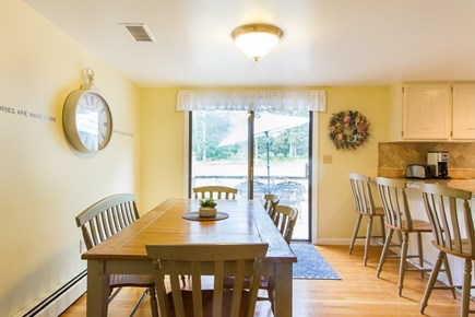 Chatham Cape Cod vacation rental - Dining area in kitchen w/sliders to back deck - table expands.
