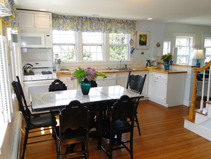 Chatham Cape Cod vacation rental - Kitchen with dining area, opens to deck