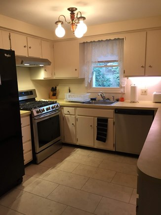 South Dennis Cape Cod vacation rental - Brand new stove and dishwasher, and connects with dining room.