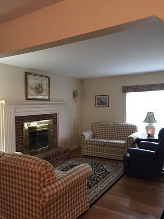 South Dennis Cape Cod vacation rental - Living room with 4 love seats.
