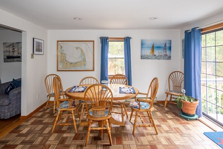 Truro Cape Cod vacation rental - Kitchen/dining area slider opens to 40 ft. deck w/gas grill, etc.