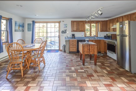 Truro Cape Cod vacation rental - Kitchen w/slider to deck is open to a large livingroom area.