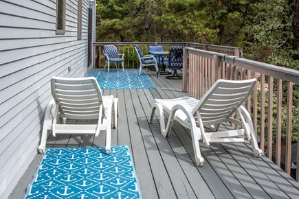 Truro Cape Cod vacation rental - 40' deck w/sliders into kitchen and another into master  bedroom.