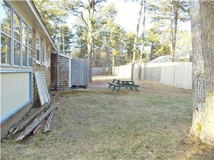Dennis Port Cape Cod vacation rental - Partially fenced back yard