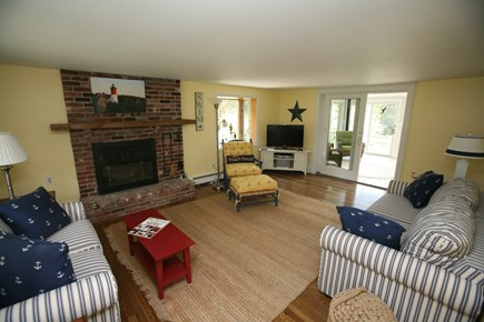 East Orleans Cape Cod vacation rental - Living room with fireplace, Cable TV, BluRay player, movies etc.
