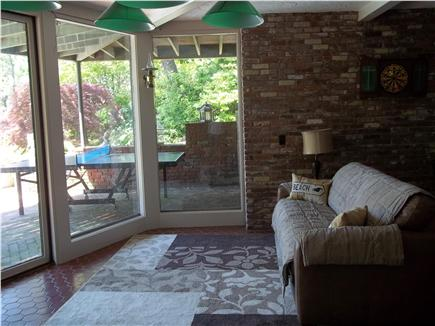 Truro Cape Cod vacation rental - Lower level living area leading to pool (queen sleeper couch).