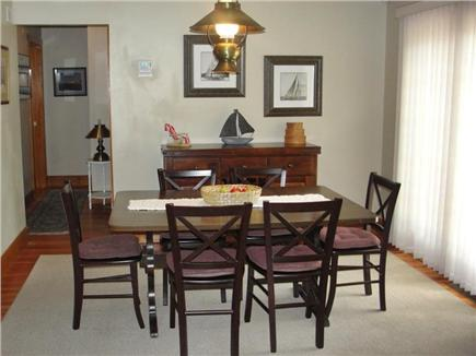 Falmouth Heights Beach Cape Cod vacation rental - Dining area adjacent to kitchen & living room w/slider to deck