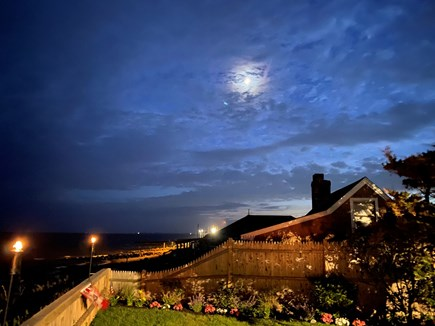 Dennisport Cape Cod vacation rental - Ocean views in the evening with Tiki torches.