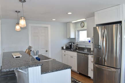 Dennisport Cape Cod vacation rental - Kitchen with counter seating.