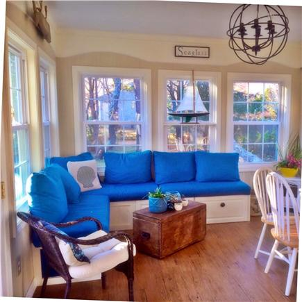 Harwichport Cape Cod vacation rental - Sun room with custom window seat, table and new flat screen t.v.