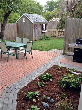 Harwichport Cape Cod vacation rental - Great fenced in backyard with shower, gas grill and patio set.