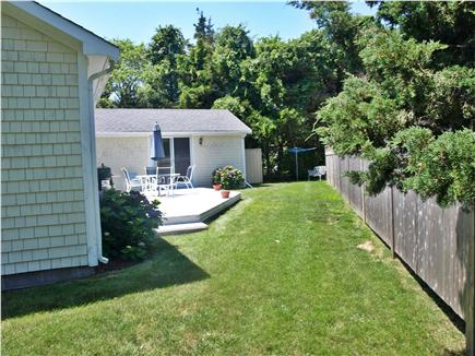 Brewster, MA Cape Cod vacation rental - View of back yard and deck