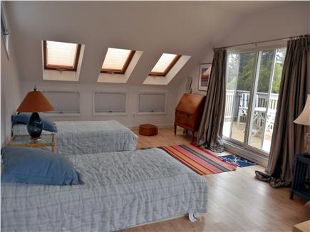 East Orleans Cape Cod vacation rental - 4th bedroom with 2 twins, futon, TV, A/C unit & deck