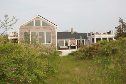 Eastham Cape Cod vacation rental - Front of house with balcony, main deck, roof deck
