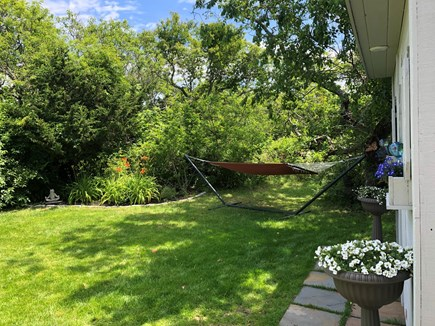 Eastham Cape Cod vacation rental - Back yard with hammock