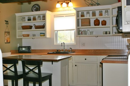 Eastham Cape Cod vacation rental - Kitchen with Island and Two Bar Stools