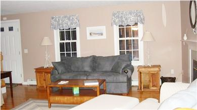 East Falmouth Cape Cod vacation rental - Family room with fireplace and cable TV