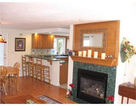 Sandwich Cape Cod vacation rental - View from front of living room towards back yard. (gas fireplace)