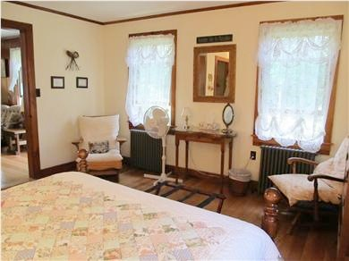 Eastham Cape Cod vacation rental - Plenty of space for relaxed seating in the queen-size bedroom!