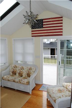 Falmouth Cape Cod vacation rental - Sunroom located off the back porch. Flat screen TV & dvd player