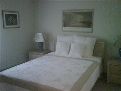 Mashpee Cape Cod vacation rental - Master Bedroom with queen bed, flat screen TV, and skylight