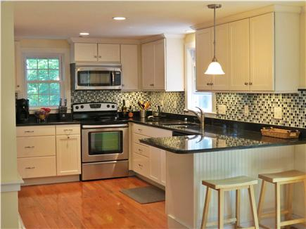 Falmouth, Sippewissett Cape Cod vacation rental - Modern kitchen with stainless steel and granite counter tops