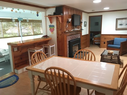 Eastham Cape Cod vacation rental - Family room with gas fireplace and dining table