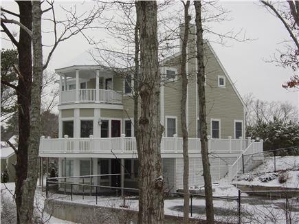 Mashpee Cape Cod vacation rental - Winter view of home from top of dock stairs