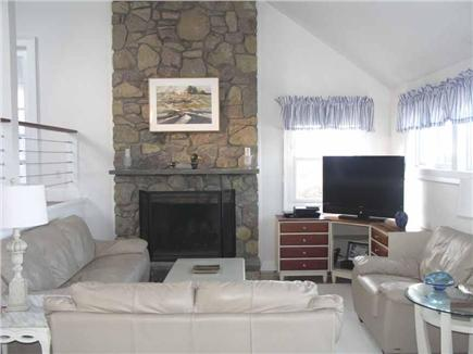 Yarmouthport Cape Cod vacation rental - The stone fireplace rises 17 feet into a vaulted ceiling.