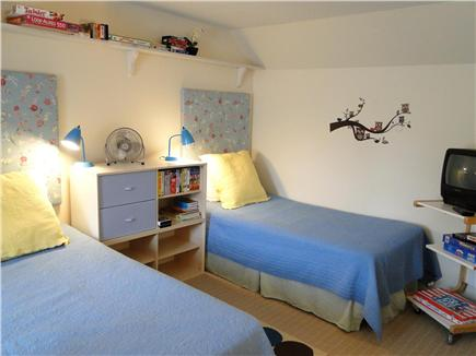 Harwich Cape Cod vacation rental - Upstairs bedroom w/ 2 twins, kids' games, ceiling fan, & full bed