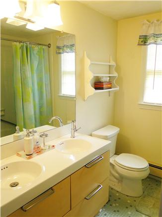 Harwich Cape Cod vacation rental - Upstairs bath with new double sinks and tub / shower