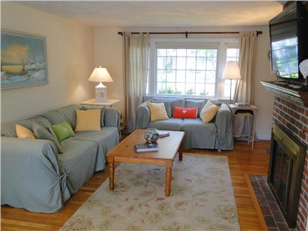 Harwich Cape Cod vacation rental - Bright living room with HD TV, fireplace, wood floors