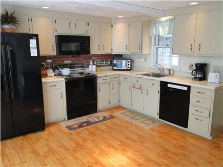 Harwich Cape Cod vacation rental - Spacious kitchen with eating nook, vaulted ceilings