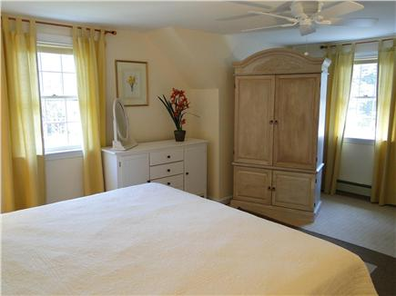 Harwich Cape Cod vacation rental - Master bedroom includes TV, ceiling fan, and half bath