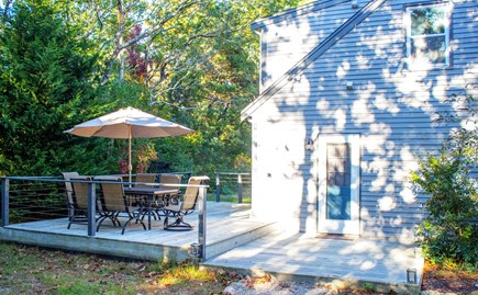 Brewster Cape Cod vacation rental - Wrap around porch with picnic table and charcoal grill.