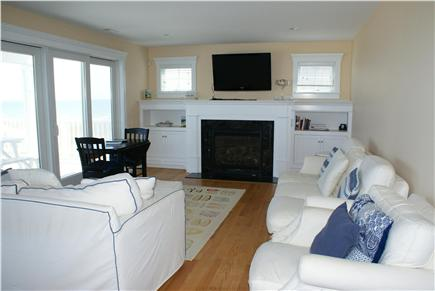 Sandwich Cape Cod vacation rental - Comfortably furnished LR with gas fireplace & ocean views.