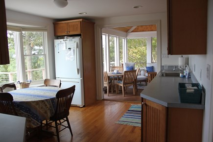 West Falmouth Cape Cod vacation rental - Kitchen with french doors opening to screen porch
