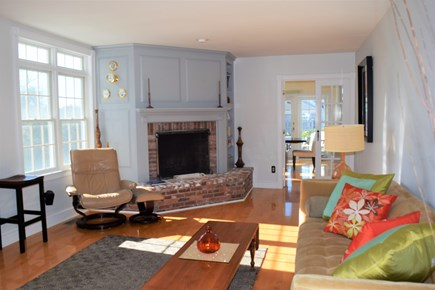Yarmouth Port Cape Cod vacation rental - Living room with fireplace and french doors to dining room