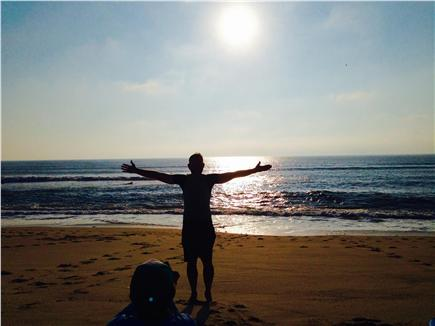 Orleans Cape Cod vacation rental - Happy guest at sunrise on the beach in front of house