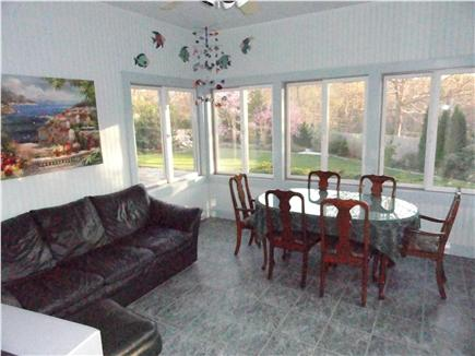 North Eastham Cape Cod vacation rental - 4 season room with leather furniture opens to back yard and deck