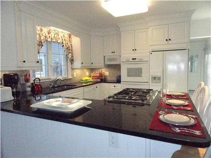 North Eastham Cape Cod vacation rental - Gourmet kitchen with granite counters and breakfast bar seating