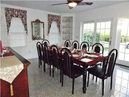 North Eastham Cape Cod vacation rental - Dining room seats 10 comfortably & opens to kitchen and patio
